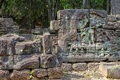 Ancient Stone Ruin In Angkor Wat Temple. Stone Carved Bas-relief Restoration. Khmer Heritage Temple  poster