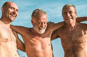 Group of senior adults at the beach poster