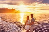Travel cruise ship couple on sunset cruise in Hawaii holiday. Two tourists lovers on honeymoon trave poster