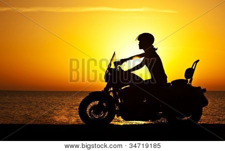 Woman biker over sunset female
