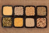 Cereal and grain selection of bulgur wheat, buckwheat, couscous, sunflower, sesame and pumpkin seed,
