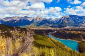 Lush multicolor autumn in the Canadian Rockies. Majestic panorama of a valley in the Rocky Mountains poster