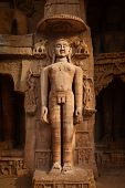 picture of jain  - Rockcut Statue of Jain thirthankara in rock niches near Gwalior fort - JPG