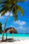 stock photo of kuramathi  - Swing on a tropical beach vacation symbol - JPG
