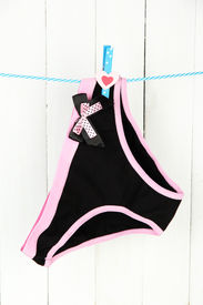 stock photo of womens panties  - Womans panties hanging on a clothesline - JPG