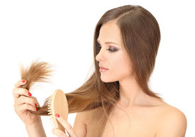 picture of split ends  - Beautiful woman holding split ends of her long hair - JPG