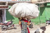 Indian Woman Carries Heavy Load On Her Head