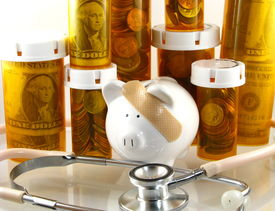 stock photo of health-care  - A piggy bank with bandage surrounded by prescription bottles and money depicting costs of healthcare - JPG