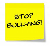 stock photo of stop bully  - Stop Bullying written on a paper yellow Sticky Note making a great concept - JPG