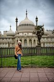 picture of saracen  - Young woman posing in front of the Brighton Palace Pavilion  - JPG