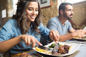 stock photo of lunch  - Couple having lunch at rustic gourmet restaurant