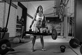 stock photo of gym workout  - Hex Dead Lift Shrug Bar Deadlifts woman at gym workout weightlifting - JPG