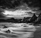 pic of long distance  - Stunning mountain and sea sunset landscape black and white - JPG