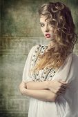 stock photo of vintage jewelry  - Sexy curly haired woman with stylish make - JPG