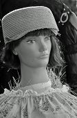 picture of scarecrow  - Scarecrow takes on a retro look with straw pillbox hat and floral dress - JPG