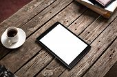 picture of internet-cafe  - Digital tablet computer with isolated screen on wooden table with cup of coffee - JPG
