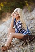 stock photo of cowboy  - Young woman portrait of a cowboy in the open air - JPG