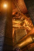 stock photo of recliner  - Reclining Buddha gold statue face - JPG