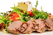 stock photo of veal meat  - Veal meat with fresh vegetable salad - JPG