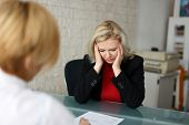 stock photo of unemployed people  - Dismissed worker in office bad news fired - JPG