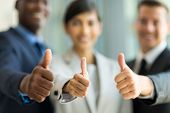 stock photo of stand up  - close up of multiracial business team giving thumbs up - JPG