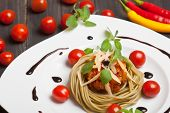 picture of oregano  - Pasta spaghetti with bolognese sauce fresh oregano and cheese - JPG