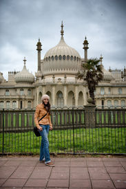 image of saracen  - Young woman posing in front of the Brighton Palace Pavilion  - JPG