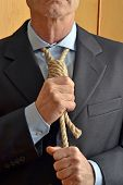 foto of hangman  - Hangman adjusting a noose rope like tie - JPG