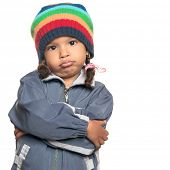 foto of rapper  - Funny mixed race little girl wearing a colorful beanie hat and a jacket with a rapper attitude isolated on white - JPG