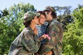 pic of reunited  - Army parents reunited with their son on a sunny day - JPG