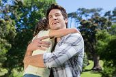 image of father daughter  - Father and daughter hugging in the park on a sunny day - JPG