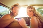 stock photo of road trip  - Hipster couple on road trip on a summers day - JPG