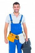 picture of overalls  - Portrait of happy workman in overalls holding toolbox on white background - JPG