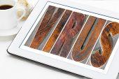 picture of virus  - virus word in vintage letterpress wood type on a digital tablet  - JPG