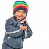 pic of beanie hat  - Funny mixed race little girl wearing a colorful beanie hat and a jacket isolated on white - JPG