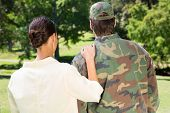 pic of reunited  - Handsome soldier reunited with partner on a sunny day - JPG