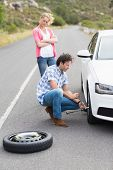stock photo of breakdown  - Couple after a car breakdown at the side of the road - JPG