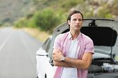 picture of breakdown  - Man waiting assistance after a car breakdown at the side of the road - JPG