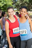 image of arms race  - Fit women before race in park on a sunny day - JPG
