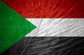 image of sudan  - Sudan flag or Sudanese banner on wooden texture - JPG