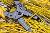 picture of stripper  - Strippers electrical tool with yellow electrical wires - JPG