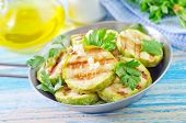 stock photo of marrow  - fried marrow in metal bowl and on a table  - JPG