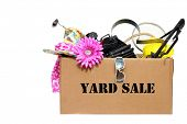 pic of yard sale  - A large cardboard box filled with Yard Sale or Tag Sale items to be sold at a discount in order to make room and make some money at the same time - JPG