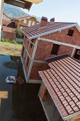 picture of flood  - Flooding Of A Court In Front Of Concstruction - JPG