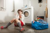 pic of laundry  - portrait of pretty woman in laundry - JPG
