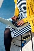 foto of work bench  - Young woman writer working with laptop on the wooden bench