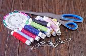 pic of rayon  - color threads and scissors on the wooden table - JPG