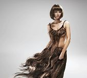 pic of hair motion  - Young woman wearing dress made of hair - JPG