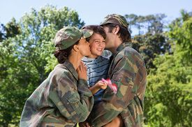 stock photo of reunited  - Army parents reunited with their son on a sunny day - JPG
