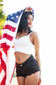 picture of independent woman  - Sexy woman with USA flag outdoor Independence day  - JPG